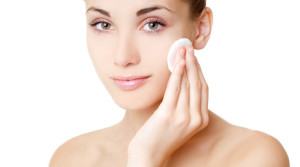 woman cleansing skin