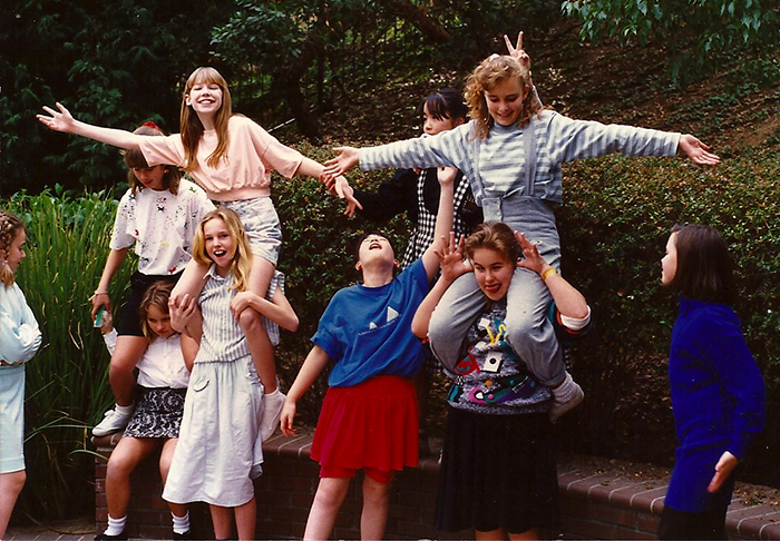 Me, at my 12th birthday party. Hands outstretched on the top left, wearing an acid wash pastel jean skirt - it was the coolest!